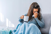 Sick woman with seasonal infections