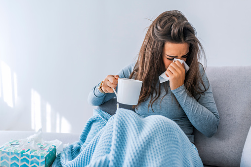 Sick woman with seasonal infections 1061849268