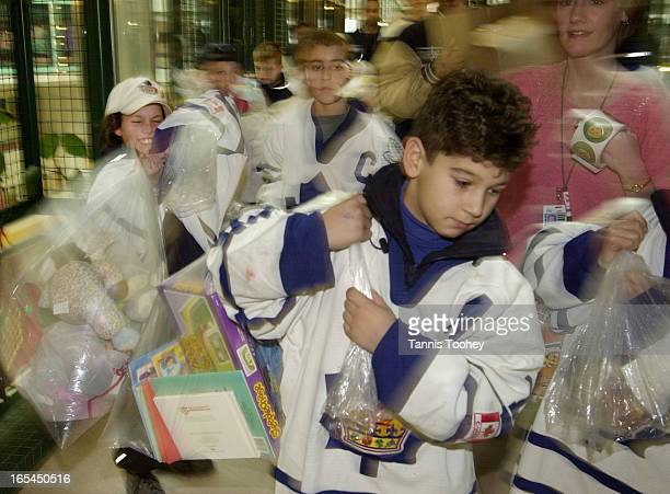 Dec82001Manny Gialedakis carries a big bag of Christmas presents along with each of his Novice triple A Toronto Marlboro teammates to donate them to...