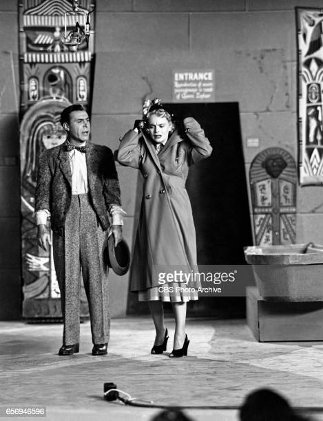 Sid Tomack and Marie Wilson rush into a museum to get out of a rainstorm on the CBS television comedy program 'My Friend Irma' during the first...
