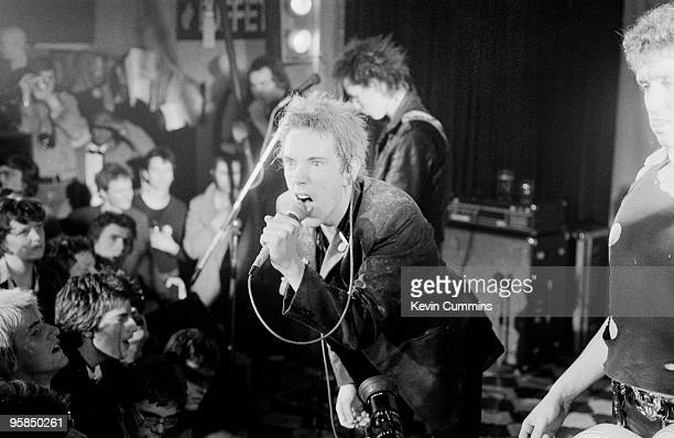 Sid Vicious Johnny Rotten and Steve Jones of British punk band the Sex Pistols perform on stage at a free concert for the children of striking...