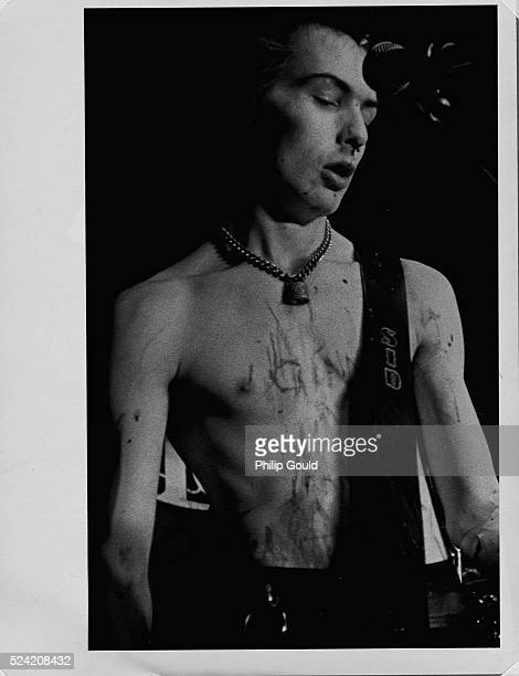Sid Vicious plays bass during a Sex Pistols concert in Dallas Texas His nose is bloodied after being punched by a fan