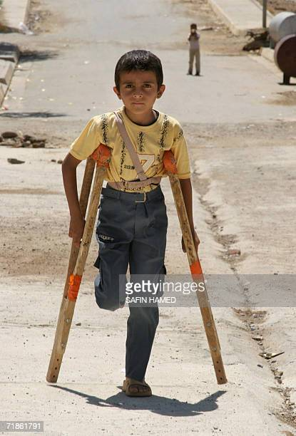 A young Kurdish mine victim walks 08 August 2006 in the northern village of Sidakan near the Iranian border Some 10 to 12 million different mines...