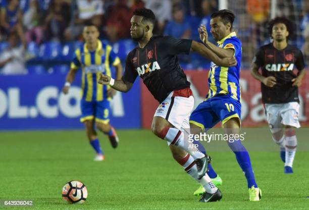 Sidcley of Brazil's Atletico Paranaense struggles for the ball with Julio Irrazabal of Paraguay's Deportivo Capiata during their Libertadores Cup...