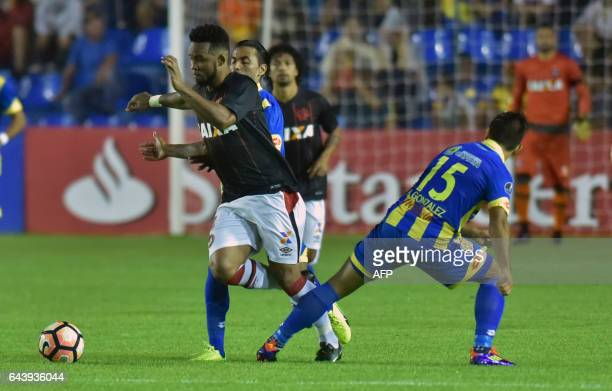 Sidcley of Brazil's Atletico Paranaense struggles for the ball with Alexis Gonzalez of Paraguay's Deportivo Capiata during their Libertadores Cup...