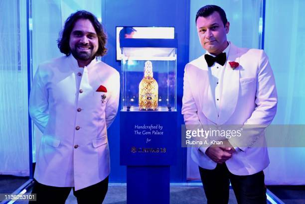 Siddharth Kasliwal and Ashish N Soni pose with the bejeweled Chivas 18 bottle designed by Kasliwal attend the third edition of Chivas 18 Alchemy 2019...