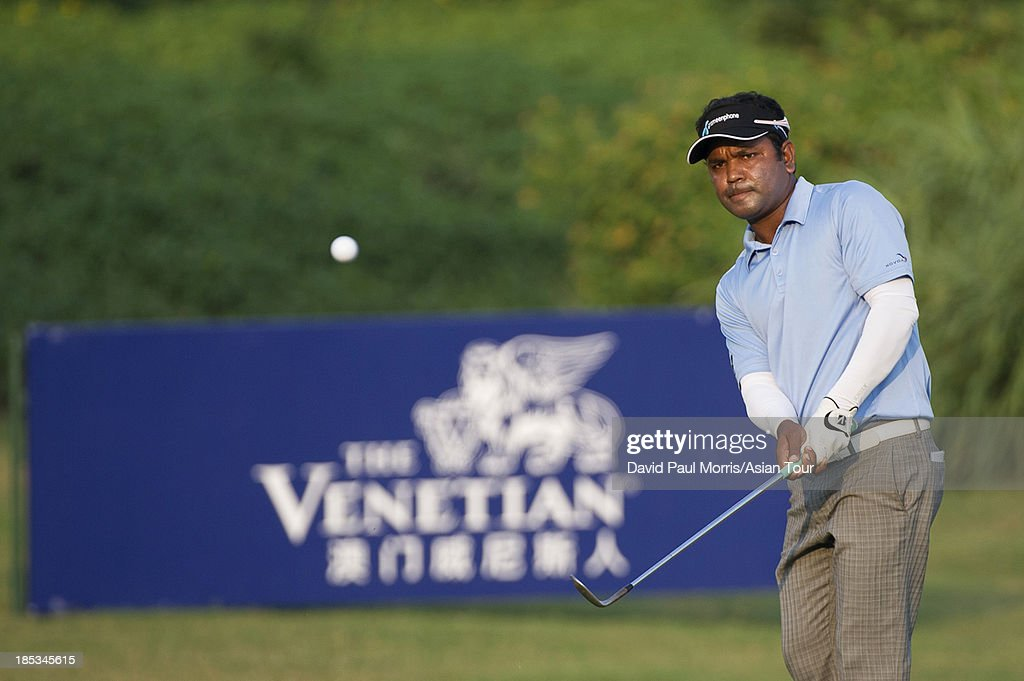 Siddikur of Bangladesh chips onto the 18th green during round three of the Venetian Macau Open on October 19, 2013 at the Macau Golf & Country Club in Macau. The Asian Tour tournament offers a record US$ 800,000 prize money which goes through October 20.