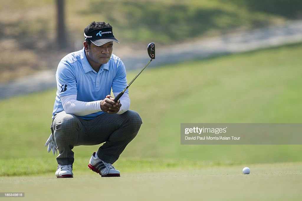 Siddikur of Bangladesh lines up his putt on the 5th green during round three of the Venetian Macau Open on October 19, 2013 at the Macau Golf & Country Club in Macau. The Asian Tour tournament offers a record US$ 800,000 prize money which goes through October 20.