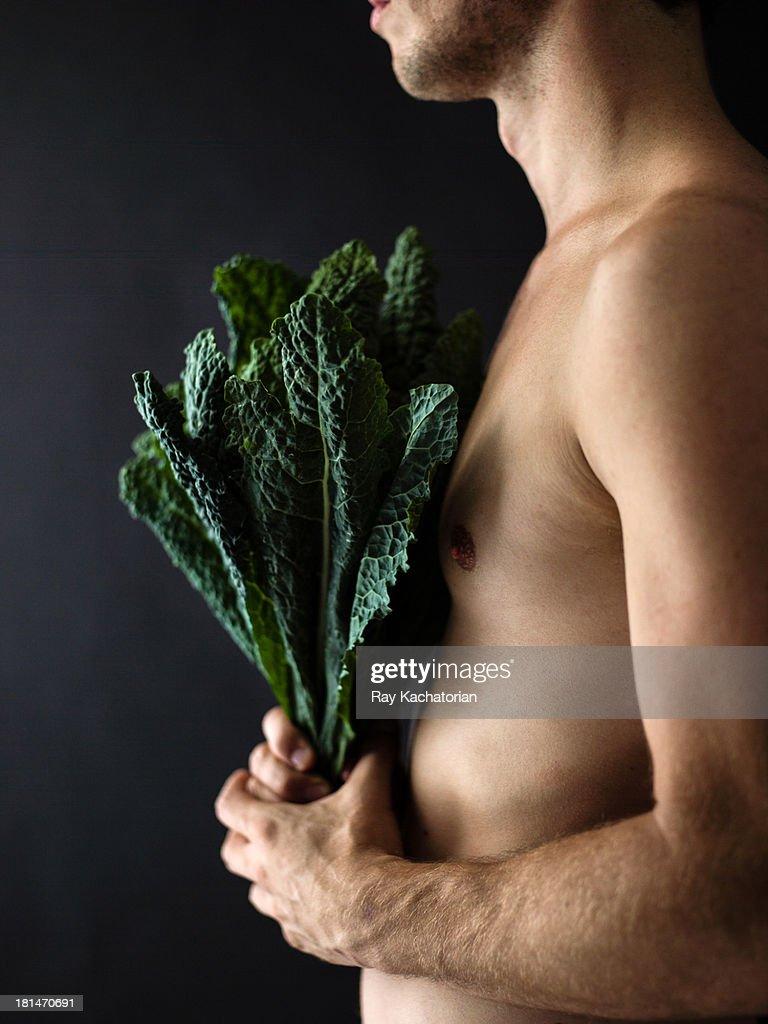 Side angel man holding kale : Stock Photo