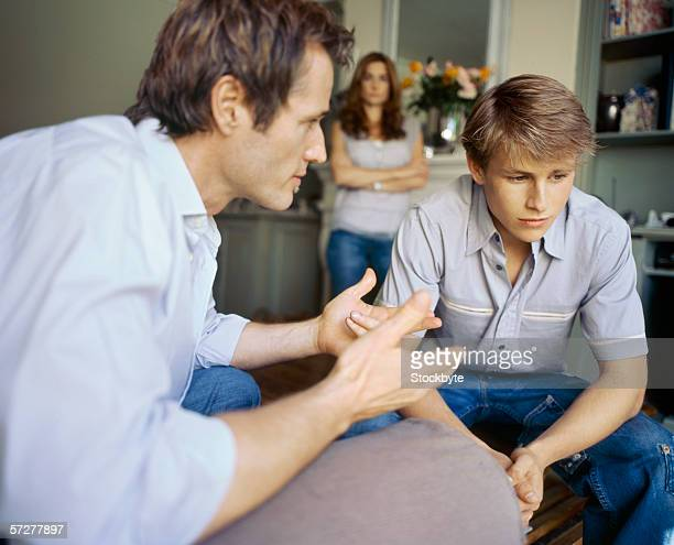Side angle of father talking to his son