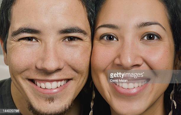 Side by side, close-up portrait of a couple
