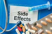 Side effects of medicine concept. Many pills and drugs.