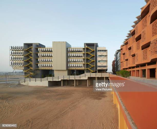 Side elevation with context. Siemens Masdar, Abu Dhabi, United Arab Emirates. Architect: Sheppard Robson, 2014.