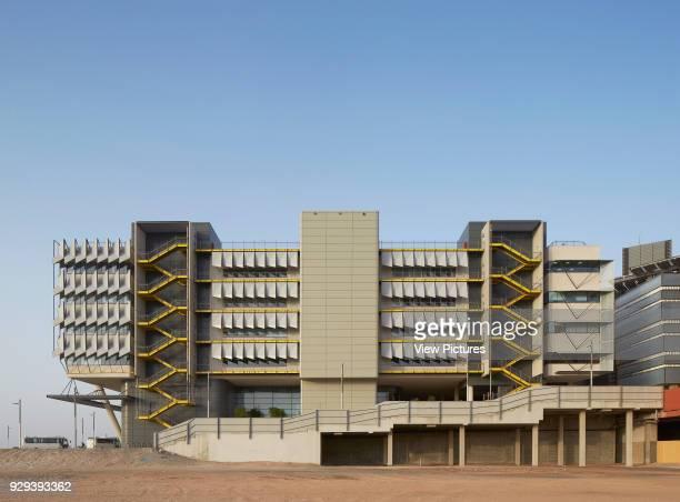Side elevation with exterior stairwell. Siemens Masdar, Abu Dhabi, United Arab Emirates. Architect: Sheppard Robson, 2014.