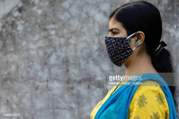 side face of an indian woman wearing homemade cotton nose mask for corona virus - india stock pictures, royalty-free photos & images