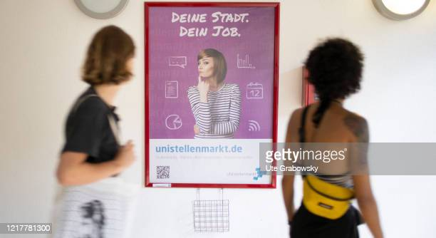 Side job wanted Students in front of a poster with the message your city your job in times of corona pandemic on May 29 2020 in Bonn Germany