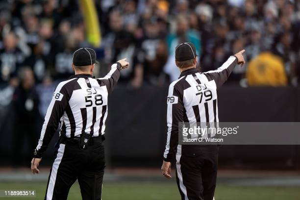 Side judge Don Willard and down judge Kent Payne point to an area of the stands where a fan was pointing a laser onto the field during the fourth...