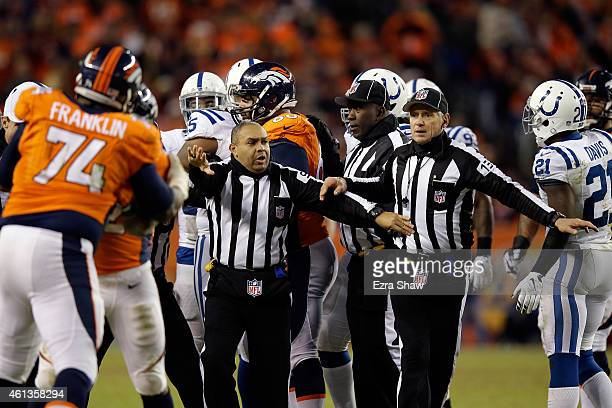Side judge James Coleman and back judge Steve Freeman work turnover seperate Denver Broncos and Indianapolis Colts players during a 2015 AFC...