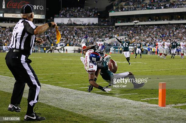 Side judge Tom Hill throws a flag as wide receiver Ramses Barden of the New York Giants is called for pass interference on cornerback Nnamdi Asomugha...