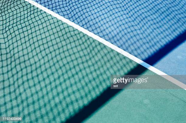 side lines of the tennis court with tennis net shadow - racket sport stock pictures, royalty-free photos & images