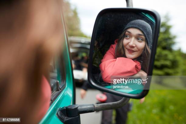 side mirror reflection of young woman in car - red jacket stock pictures, royalty-free photos & images
