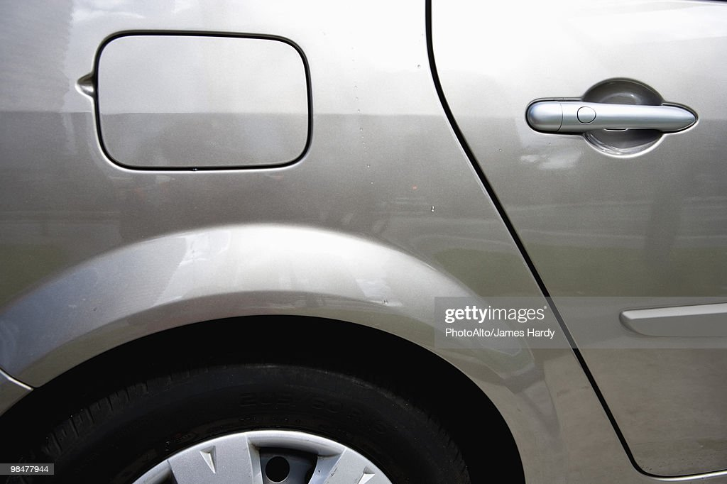 Side of car, view of gas tank : Stock Photo