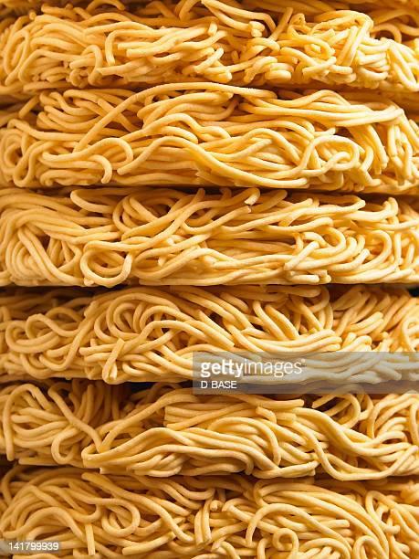 Side of instant noodle piled up
