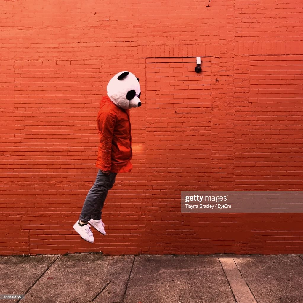 Side Of Person Jumping Against Wall : Stock Photo
