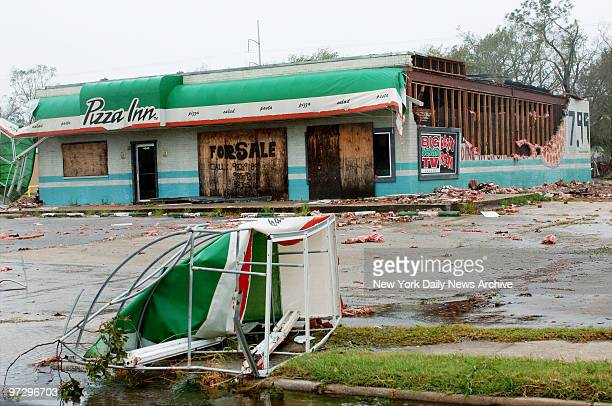 Side of the Pizza Inn in Port Arthur Tex has been stripped to the beams after the town took a direct hit from Hurricane Rita which pummeled East...