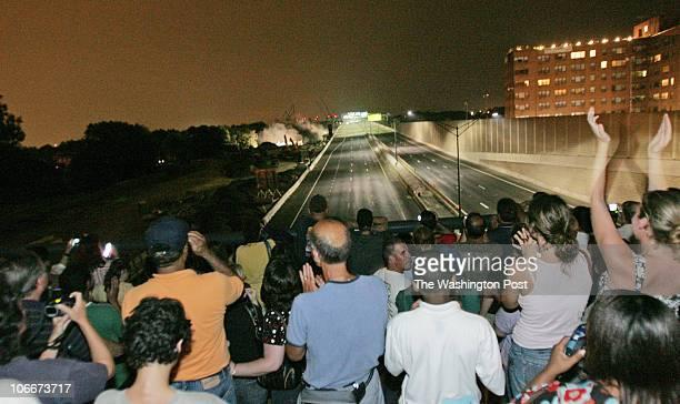 Side of Woodrow Wilson Bridge, Alexandria, VA Blowing up the old Woodrow Wilson Bridge and the people who come to watch it. A crowd of 100 people...
