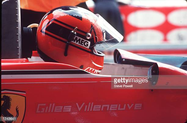 A side on view of the late Gilles Villeneuve the legendary French Canadian driver as he sits on the grid contemplating the start of the race Gilles...