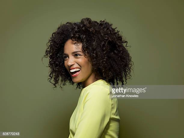 Side portrait of a dark skinned female, laughing