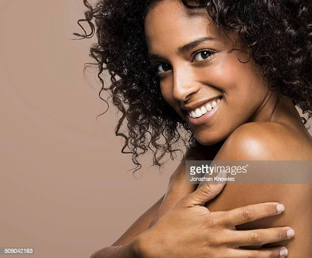 side portrait of a dark skinned female, smiling - naked stock pictures, royalty-free photos & images