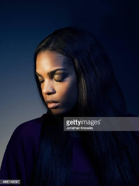Side portrait of a dark skinned female,eyes closed
