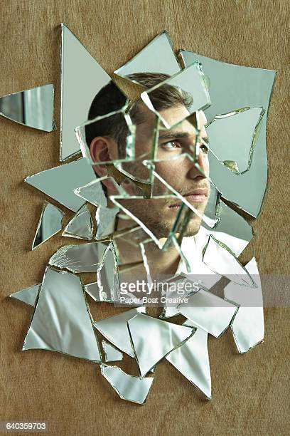 Side portrait of a man through a group of mirrors
