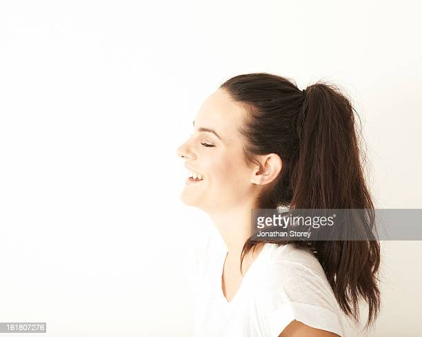 Side portrait of girl closed eyes, laughing.