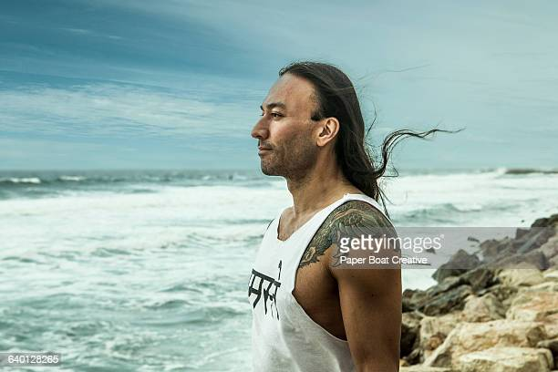 Side portrait of yoga instructor by the beach side