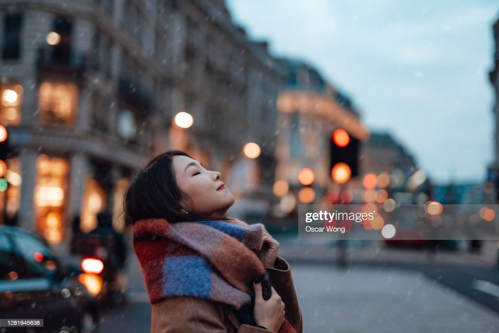Side Portrait Of Young Woman With Scarf On The City Street : Stock Photo