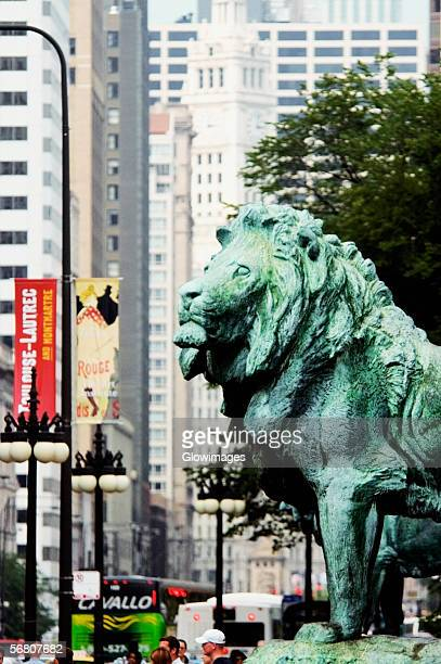 side profile of a bronze lion statue, art institute of chicago, chicago, illinois, usa - art institute of chicago stock pictures, royalty-free photos & images