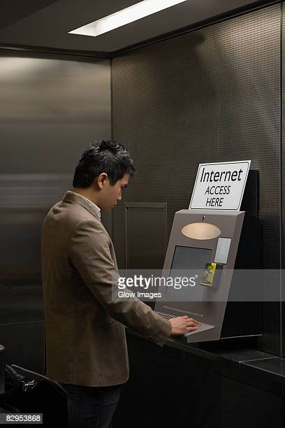 Side profile of a businessman surfing internet at an airport