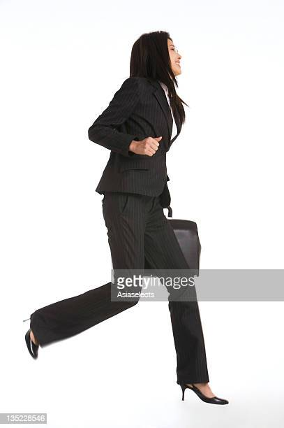 Side profile of a businesswoman running