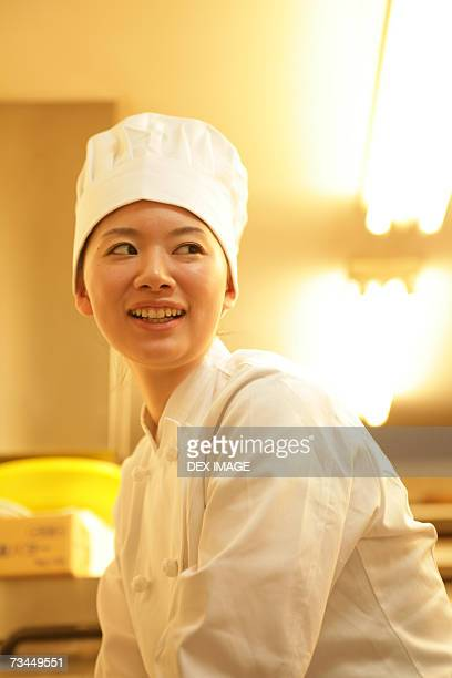 Side profile of a female chef smiling
