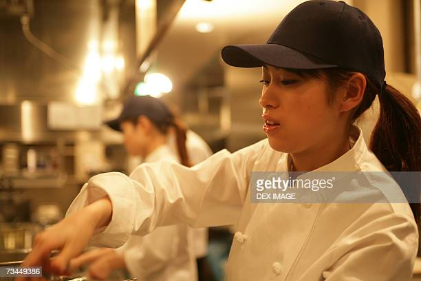 Side profile of a female chef working