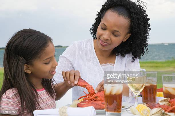 Side profile of a girl and her mother having breakfast