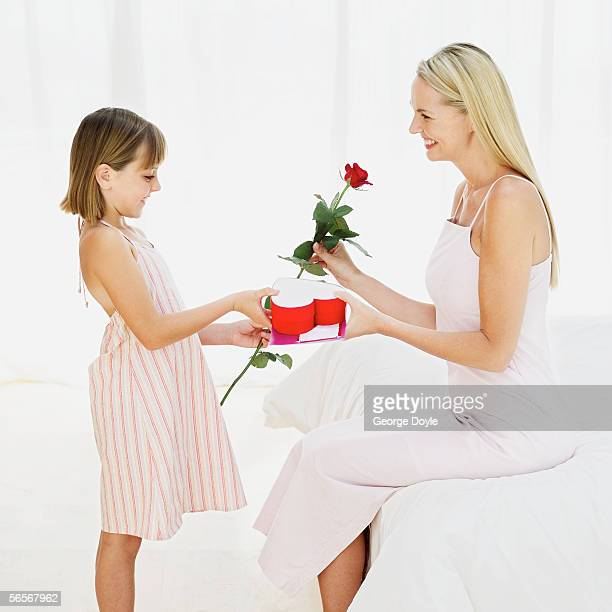 side profile of a girl giving her mother a valentine gift