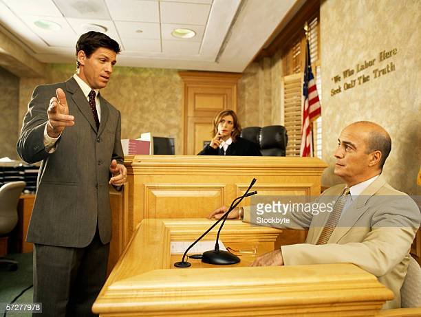 side profile of a lawyer and a witness on the witness stand - witness stock pictures, royalty-free photos & images