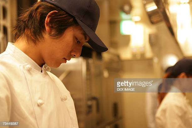 Side profile of a male chef looking down