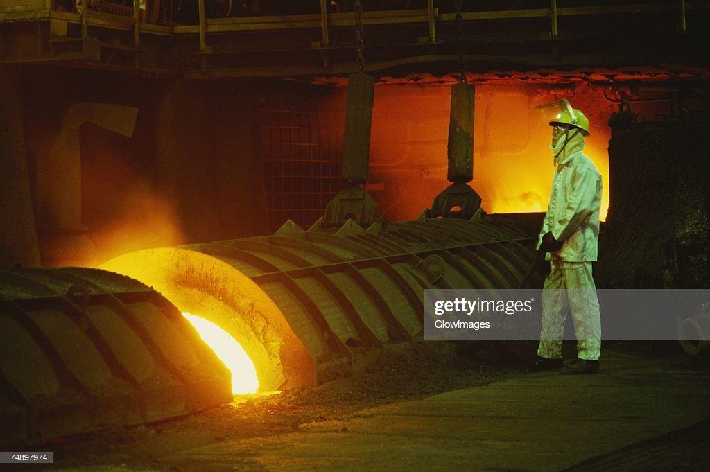 Side profile of a male worker working in a steel mill, Kawasaki, Honshu, Japan : Stock Photo