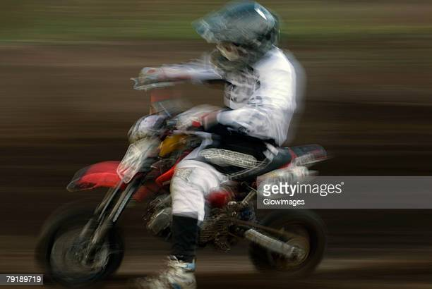 Side profile of a man riding a motorcycle in a sports race