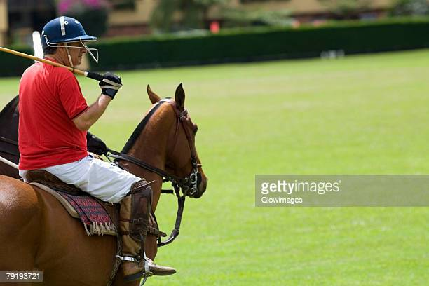 Side profile of a mature man playing polo